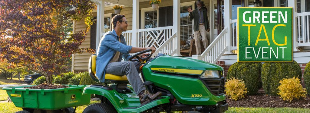 Picture of Man Riding John Deere Tractor